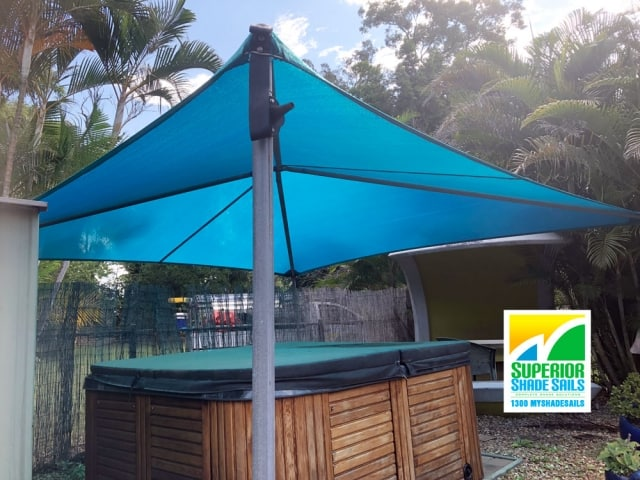 Replacement shade sails over the Spa and Driveway for this home at Pallara in the lovely Z-16 Turquoise using Hyp and ridge structures. Spa is looking good