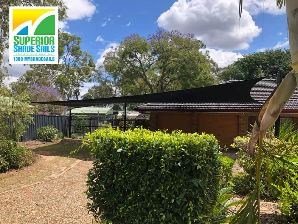 Fit 4-5 cars under this Carport Shade Sail. This 5 Point sleek black shade sail was set up in Forestdale using the Rainbow Extreme 32 shade cloth