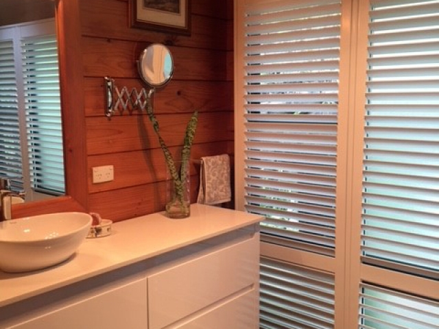 Bathroom Shutter installation for the home, apartments, and outdoor patios - Superior Shade Sails