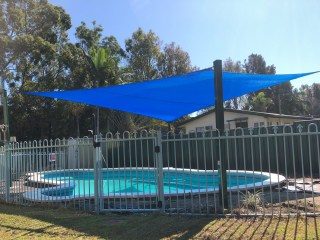 We recently replaced the shade sails over this pool using the Rainbow Z-16 Blue shade sail with Cottage Green posts, ready for the fun in the sun
