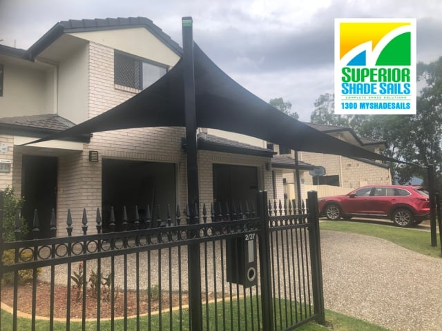 Carport Shade Sail installed at Forest Lake using Rainbow Z16 Black Fabric  by Superior Shade Sail