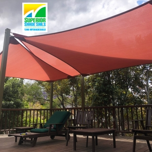 High on a hilltop in the lovely suburb of Tarragindi we installed this triple treat set of shade sails for the Poolside Deck using the Z-16 shade fabric in the Terracotta colour.