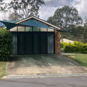 Driveway Shade Sail in New Beith in Z16 Rainforest Green installed by Superior Shade Sail Brisbane