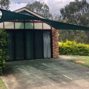 Driveway Shade Sail in New Beith in Z16 Rainforest Green installed by Superior Shade Sails, Brisbane