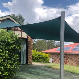 Driveway Shade Sail in New Beith in Z16 Rainforest Green installed by Superior Shade Sails Brisbane