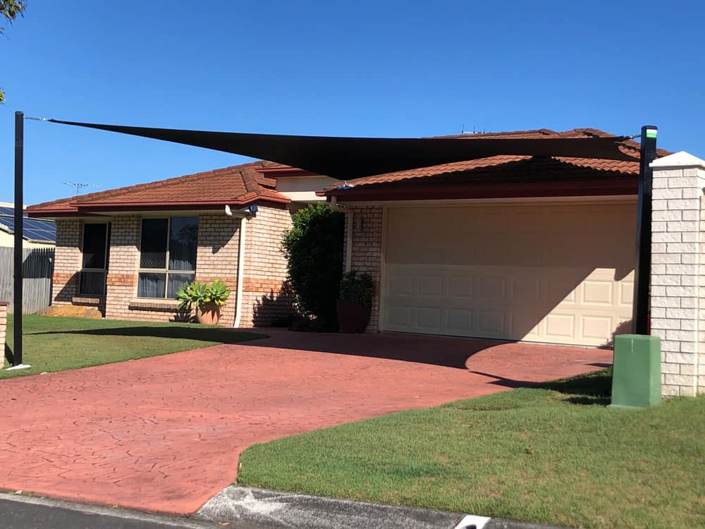 5 Point Shade Sail installed at Parkinson by Superior Shade Sails using 3 roof anchors and 2 steel posts i